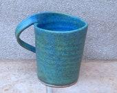 Left handed coffee mug tea cup wheelthrown in stoneware hand thrown ceramic handmade pottery lefthanded