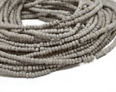 2-3mm Light Gray Coconut Shell Pucalet Rondelle Beads Dyed and Waxed 15 inch strand