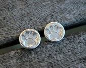 Silver hoop earrings with tiny silver pawprints