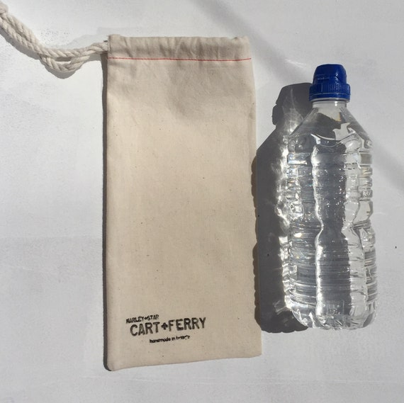 The Water Carrier, festival water carrier, organic cotton, gifts, festival essentials, red stiching, stamped, washable