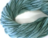 Thick and thin handspun yarn spun in merino wool, super bulky weight, 57 yards 3.35 ounces/ 95 grams