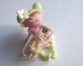 Miniature fairy doll figurine with tiny faux sweet jar