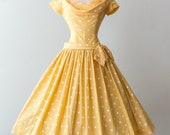 Vintage 1950s Dress - 50s Yellow Polka Dot Cotton Party Dress With Full Skirt Dropped Waist And Bow // Waist 26