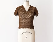 Vintage & Retro Shirts, Halter Tops, Blouses 1930s Crochet Blouse  30s Brown Puff Sleeve Top  Size XS 00 0  30s Hand Crocheted Shirt  1930s Handmade Knit Cotton Cropped Top $88.00 AT vintagedancer.com
