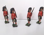 Set of four Lead Kilted Soldiers made by Britains Ltd with moving rifle arm