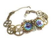 Bracelet hibou steampunk yeux bleus et violets.