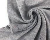 Sweatstoff Bauwolle Konfetti Sprenkel, grau