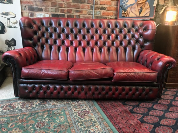VINTAGE CHESTERFIELD : Red leather monksback 3 seater settee / sofa.