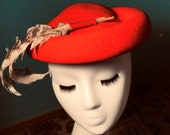 1950s Women's Hat Styles & History Red Beret toppercalot 1950s womens hat with 2 Pheasant feathers secured on top and curled on the sideVery avant garde beatnick 35.00 $35.00 AT vintagedancer.com
