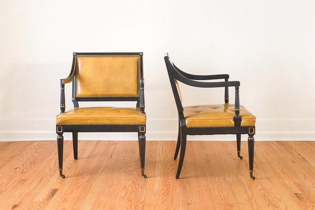Pair of mustard yellow leather captain s arm chairs with brass