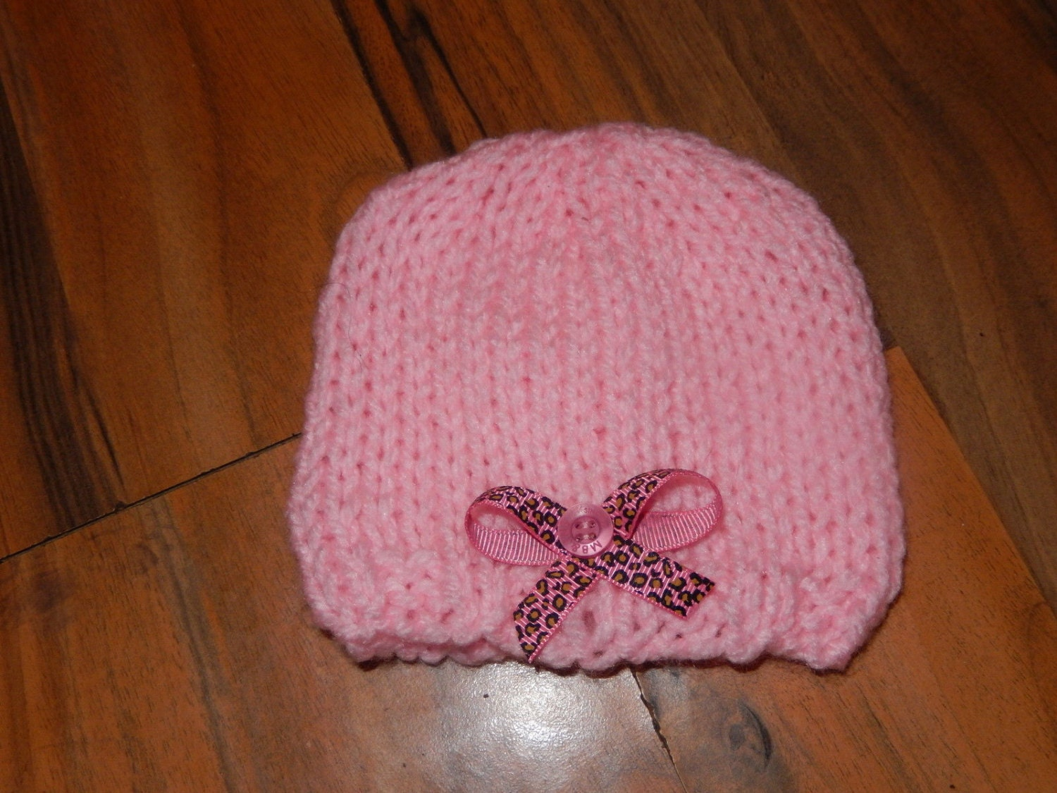 SALE hand knitted baby hat pink with a leopard print bow newborn