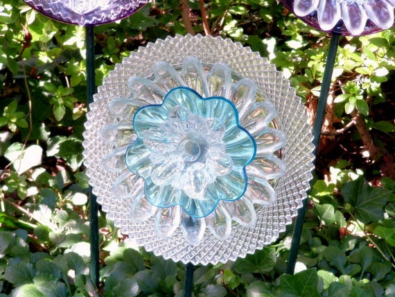 Garden art.  Glass flowers.  Blue center.