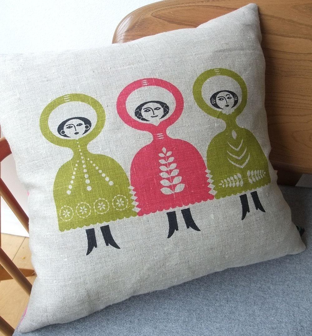 Folkdance cushion on natural linen