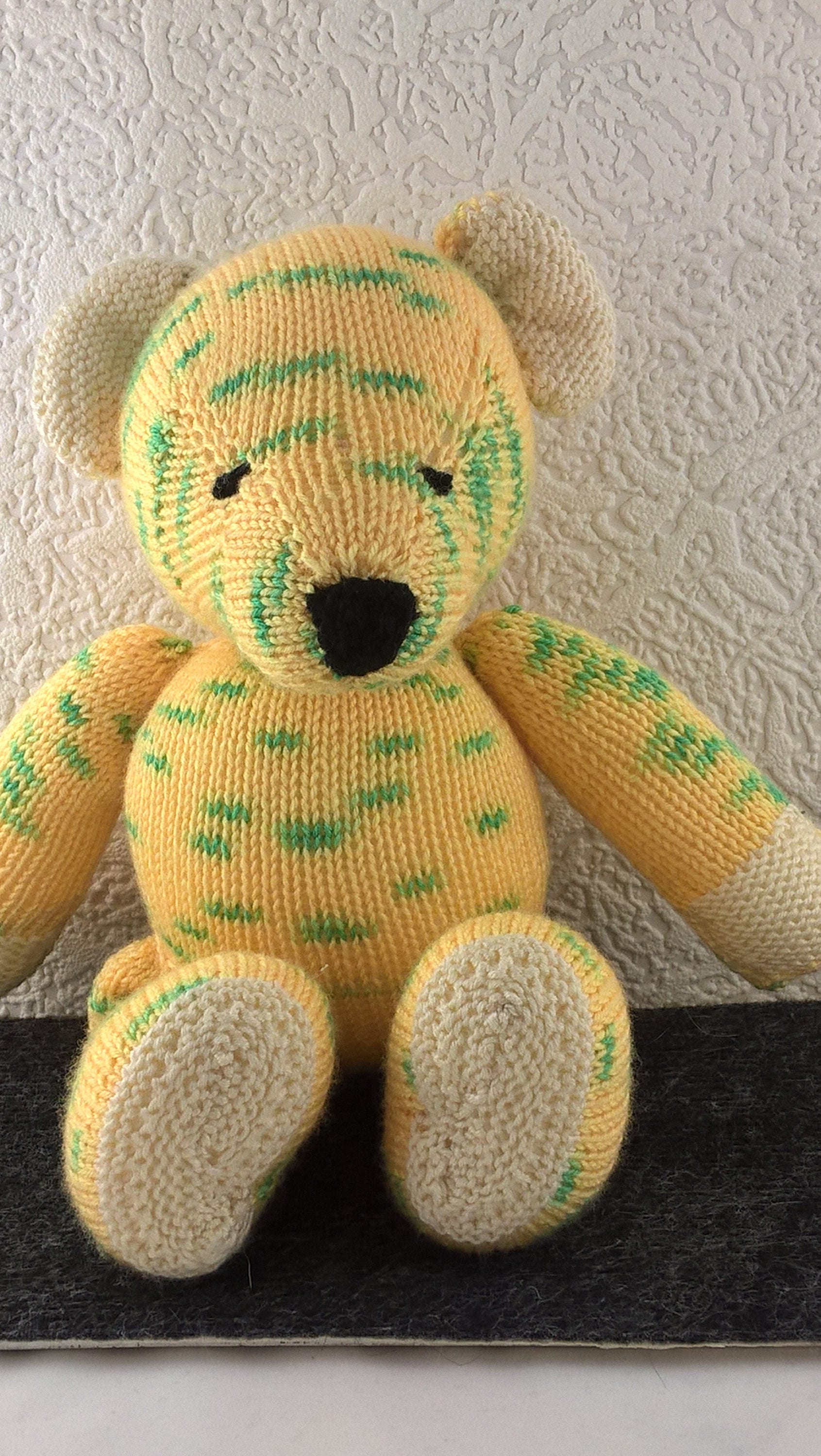 Soft yellow green and cream teddy bear. Hand knitted baby toy . Measures approx 13inches. Baby shower gift. Newborn infant or toddler toy.