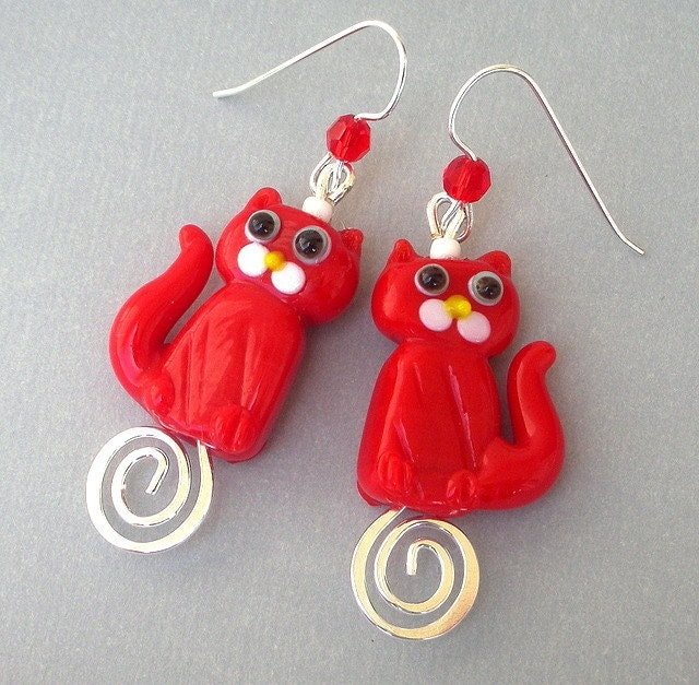 Red cat earrings, lampwork glass on silver swirls - Mindielee