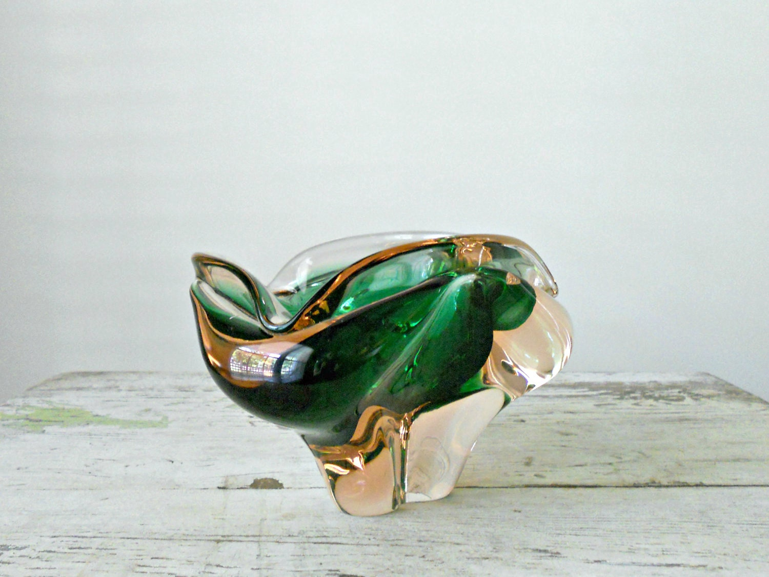 freeform organic glass bowl in gold, clear, and emerald green