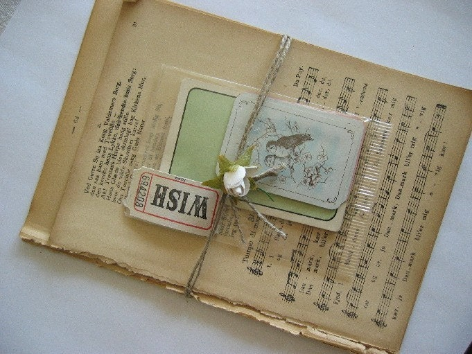Art Kit no. 1 - Vintage book pages and old playing cards.