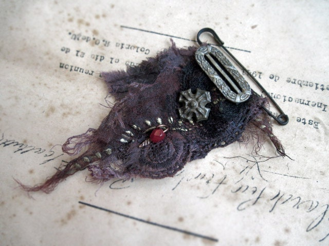 The Wind of the Wing of Madness. Brooch.