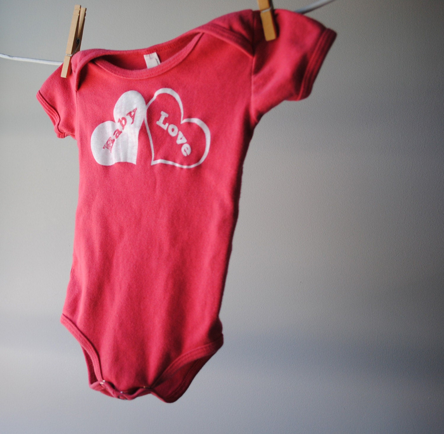 Baby Love Bodysuit - Strawberry Reddish Pink with White Ink, sized 6 to 12 months