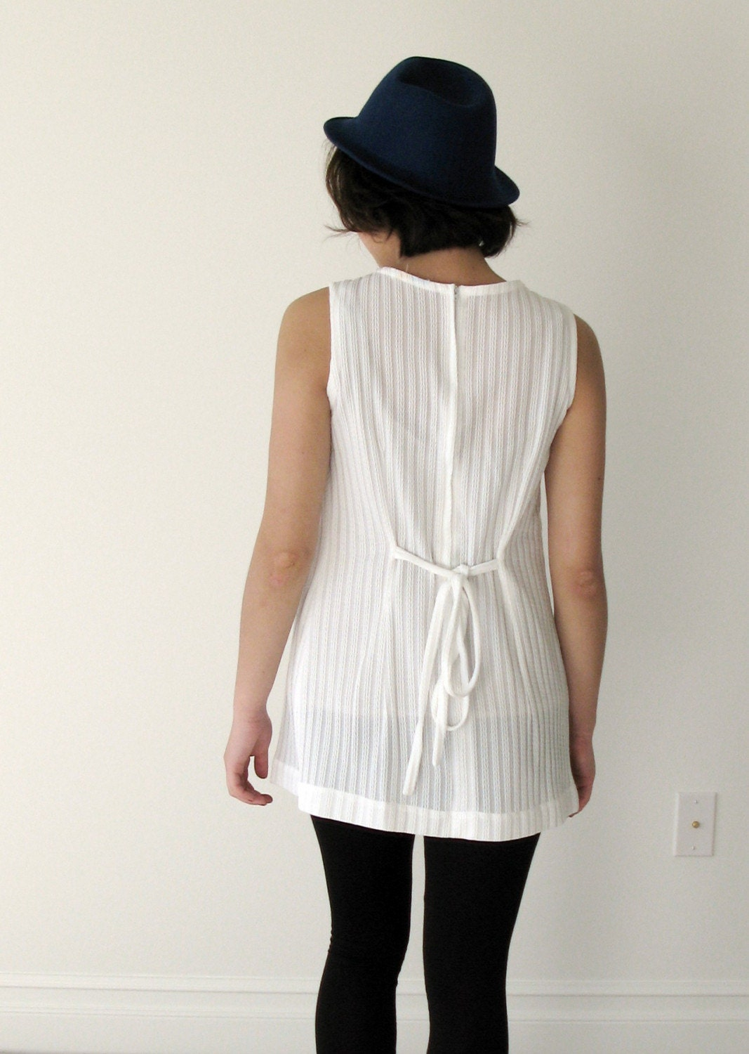 <br />Vintage 70s white top with floral details.