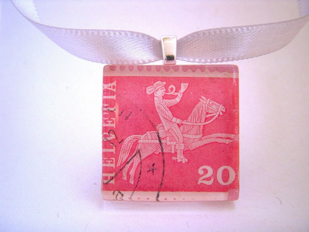 Vintage Swiss Postage Stamp Necklace. Helvetia Cowboy. Handcrafted by Juanitas on Etsy.