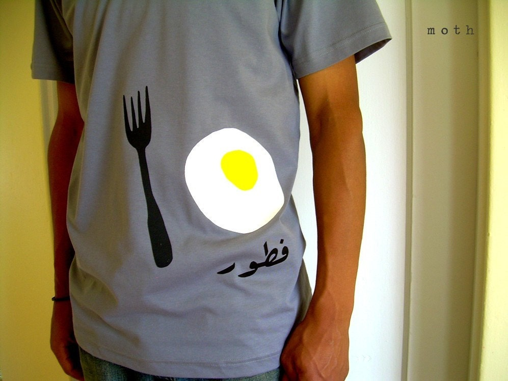 this shirt says 'breakfast' in <span class=