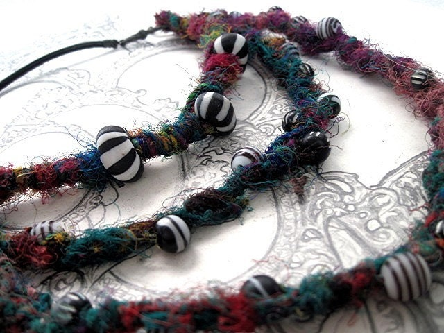 A song for my unseen friends.  Recycled Sari Yarn and Trade Beads.