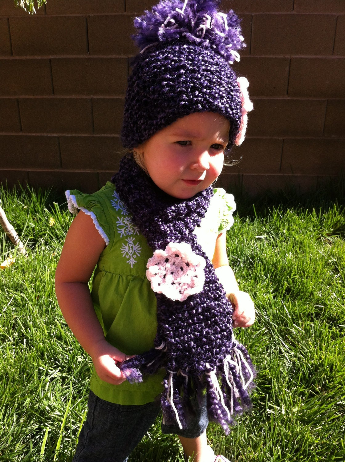 Children's Hand knitted scarf with a large crochet flower - Color shown is Gothic
