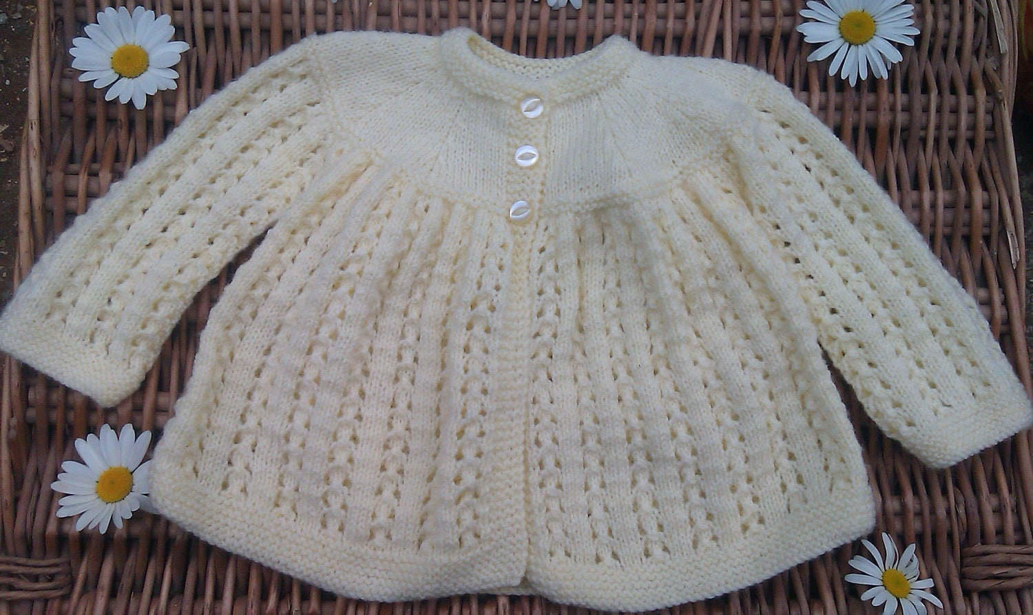 Baby's traditional yellow lacy matinee jacket
