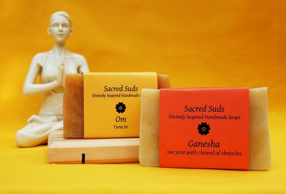 Yoga gift set of Om (Aum) and Ganesha, handmade citrus essential oil soaps (vegan, all natural).  Includes wooden self-draining soap dish and gift wrap.