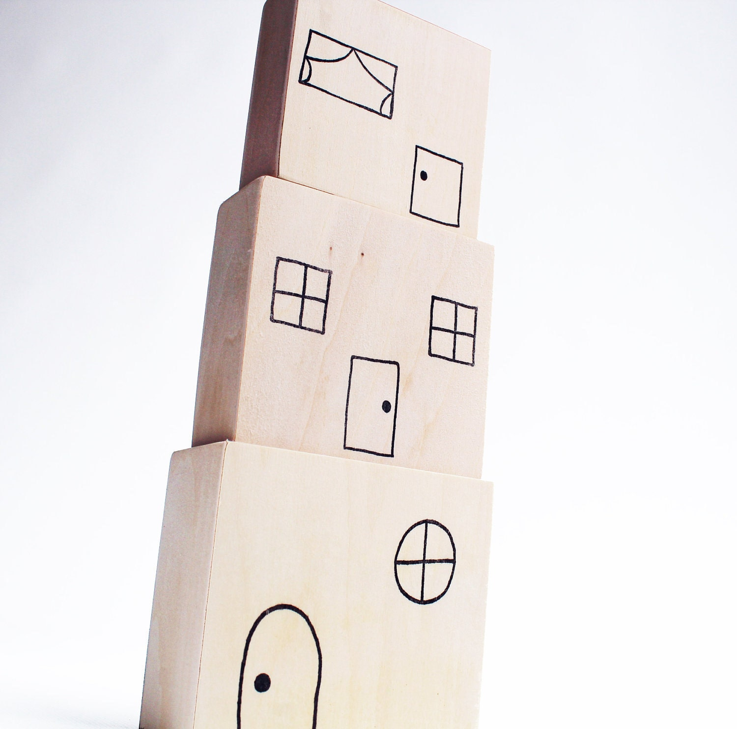 Stacking Town - a Montessori and Waldorf Inspired Stacking and Nesting Toy - MamaMayI