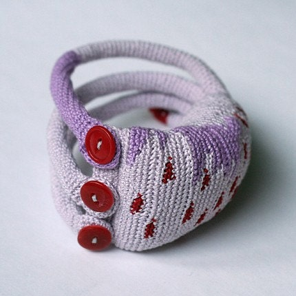 Lavender crochet cuff with red dots