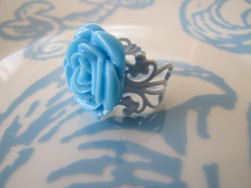 CARIBBEAN -- blue rose cabochon ring on a light blue filigree band