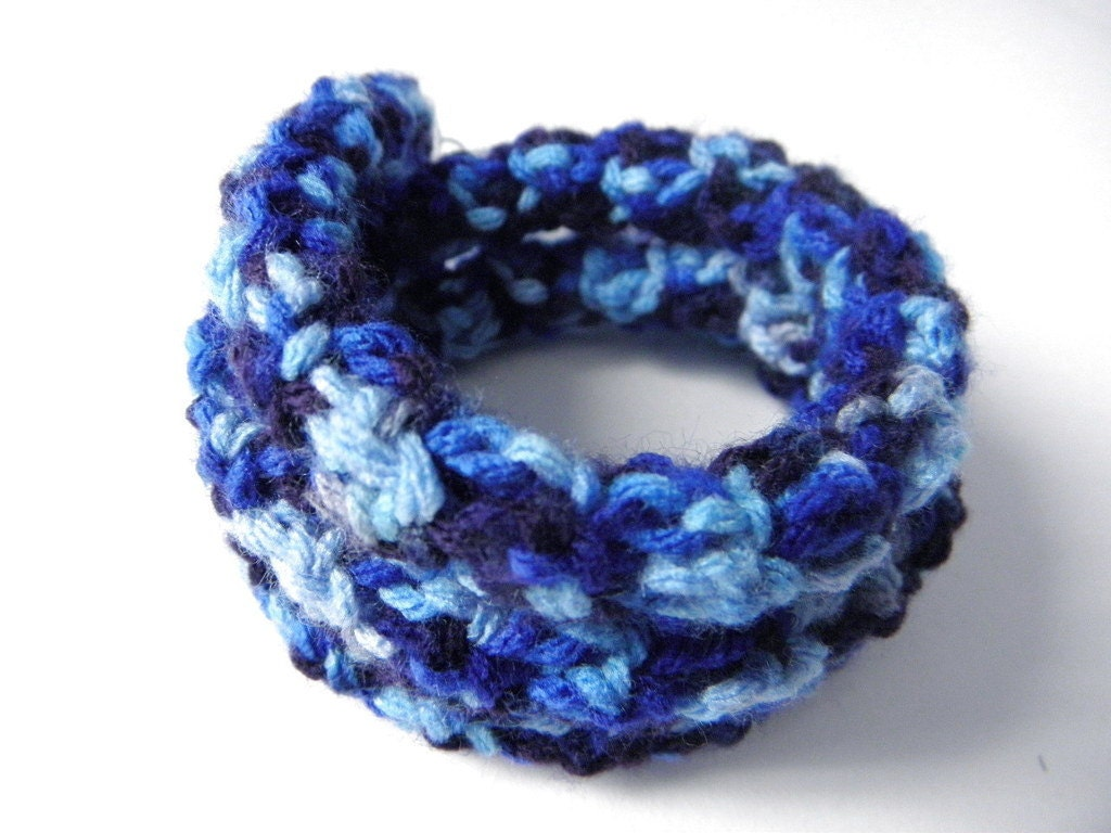 Crocheted wire bracelet in soft blue gradient