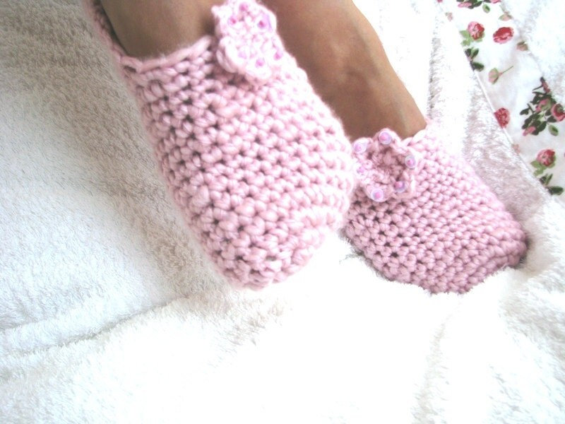 Soft pink slippers with flower
