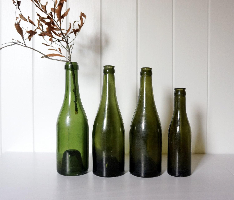 Set of four old dark green bottles - AlbertandGrace