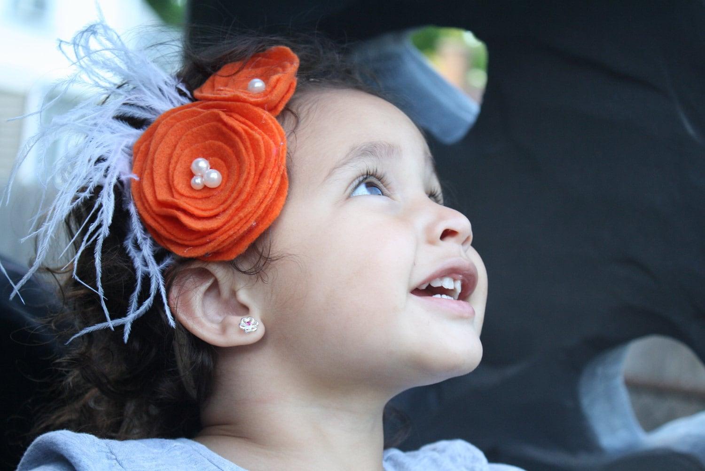 Orange Rosette Headband With Feathers