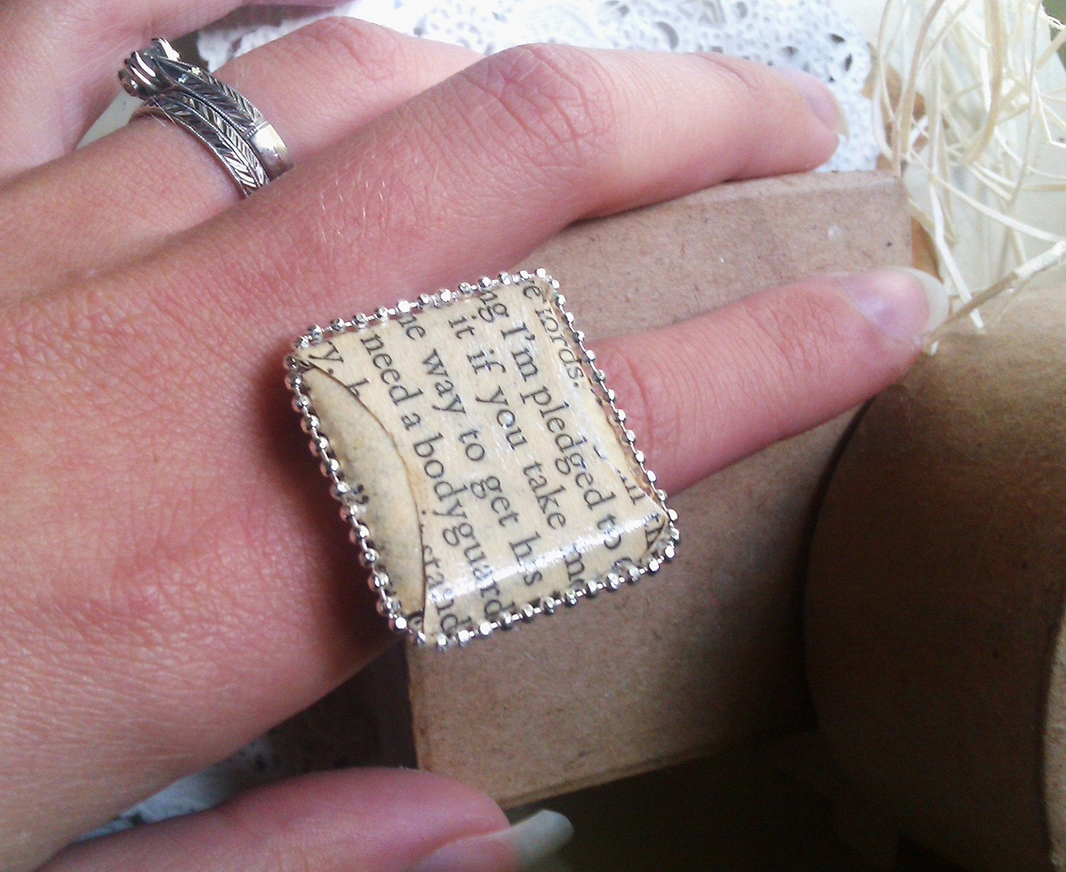 Square romance novel text ring made from folded glazed paper - fully adjustable