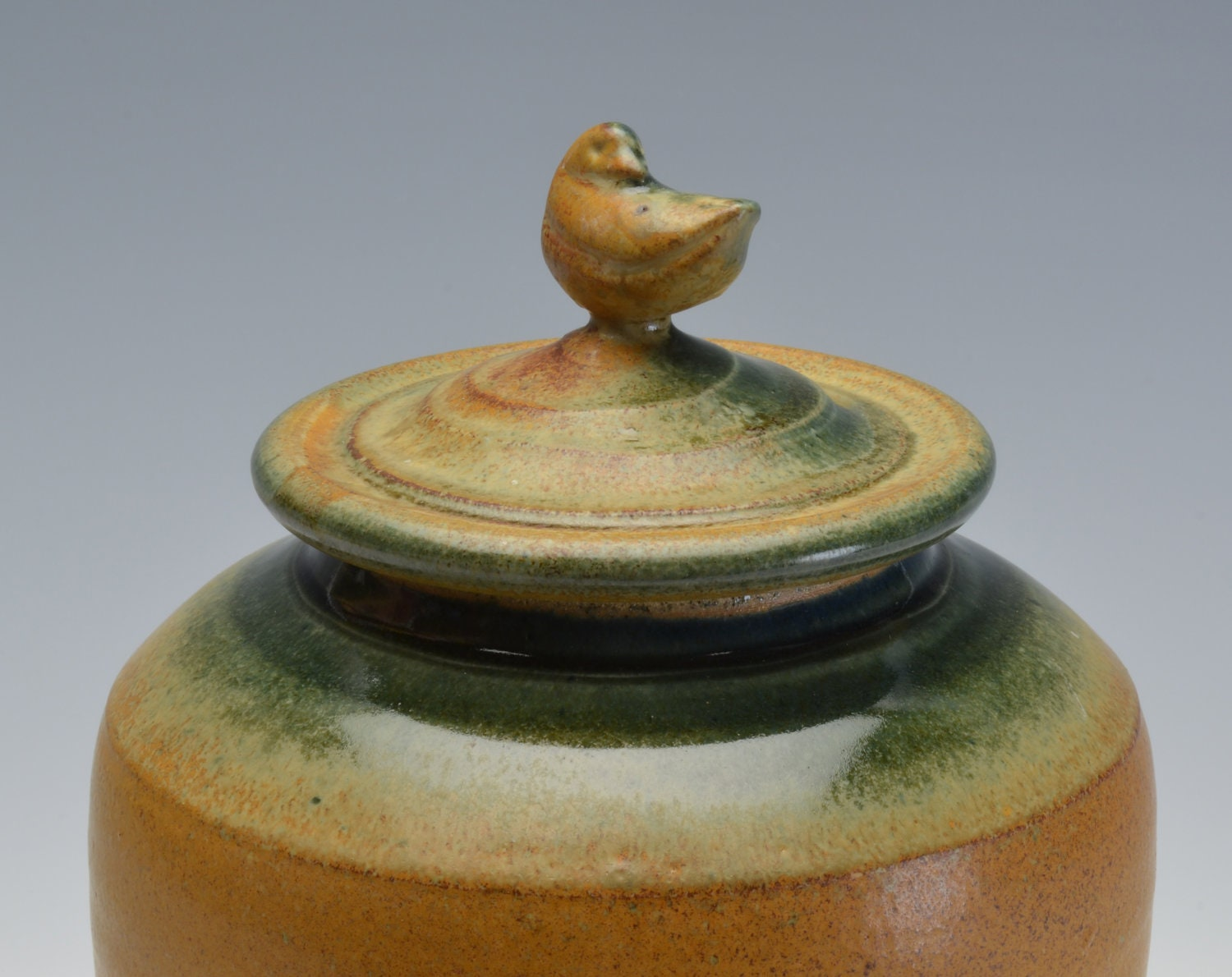 Memorial/Cremation Urn sculpted Bird with earthy ochre and blue green glazes variation 2