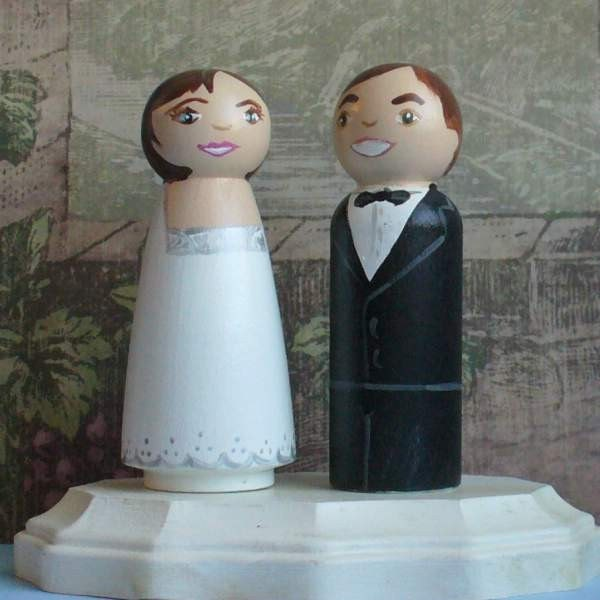 I love these personalized wedding cake toppers that are on Etsy