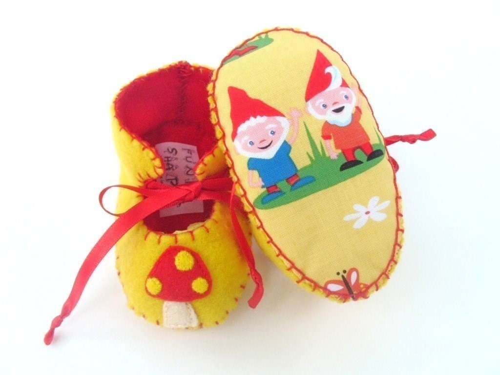 ONE OF A KIND SUPER CUTE YELLOW AND RED MUSHROOM AND GNOMES UNISEX BABY BOOTIES with Gnomeville fabric soles by Michael Miller