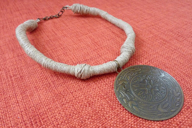 WOW Pendant. Round metal pendant , handmade hemp wrapped cord.