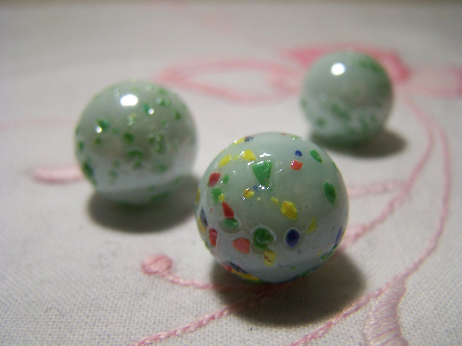 Green Glass Marble : Vintage light green speckled glass marbles