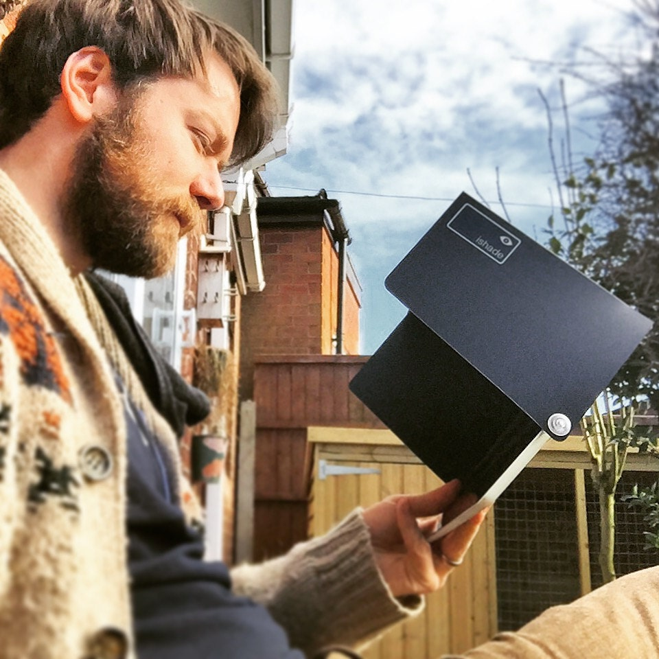 A sunshade for MacBooks  iPads. The iShade is a sunshade for your screen. It keeps the glare off when its sunny outside. Ideal for outdoor