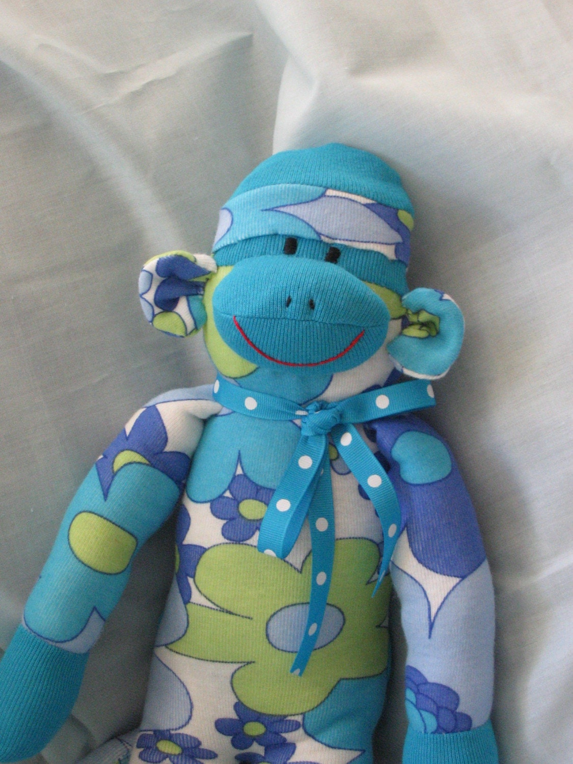 MONKEY SOCK DOLL. ADORABLE BRIGHT BLUE FLORAL PRINT MONKEY.  Cute, Bright, Colorful Blue Monkey Sock Doll in Cotton Lycra.  Very Soft.