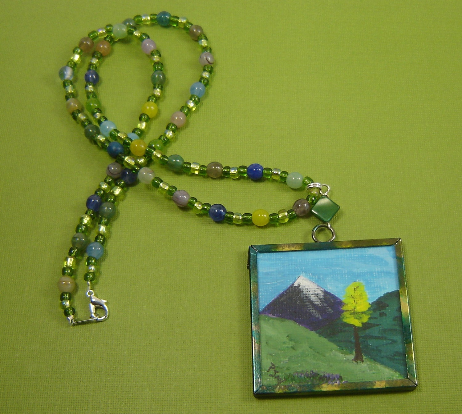 Mountain painting in metal frame necklace