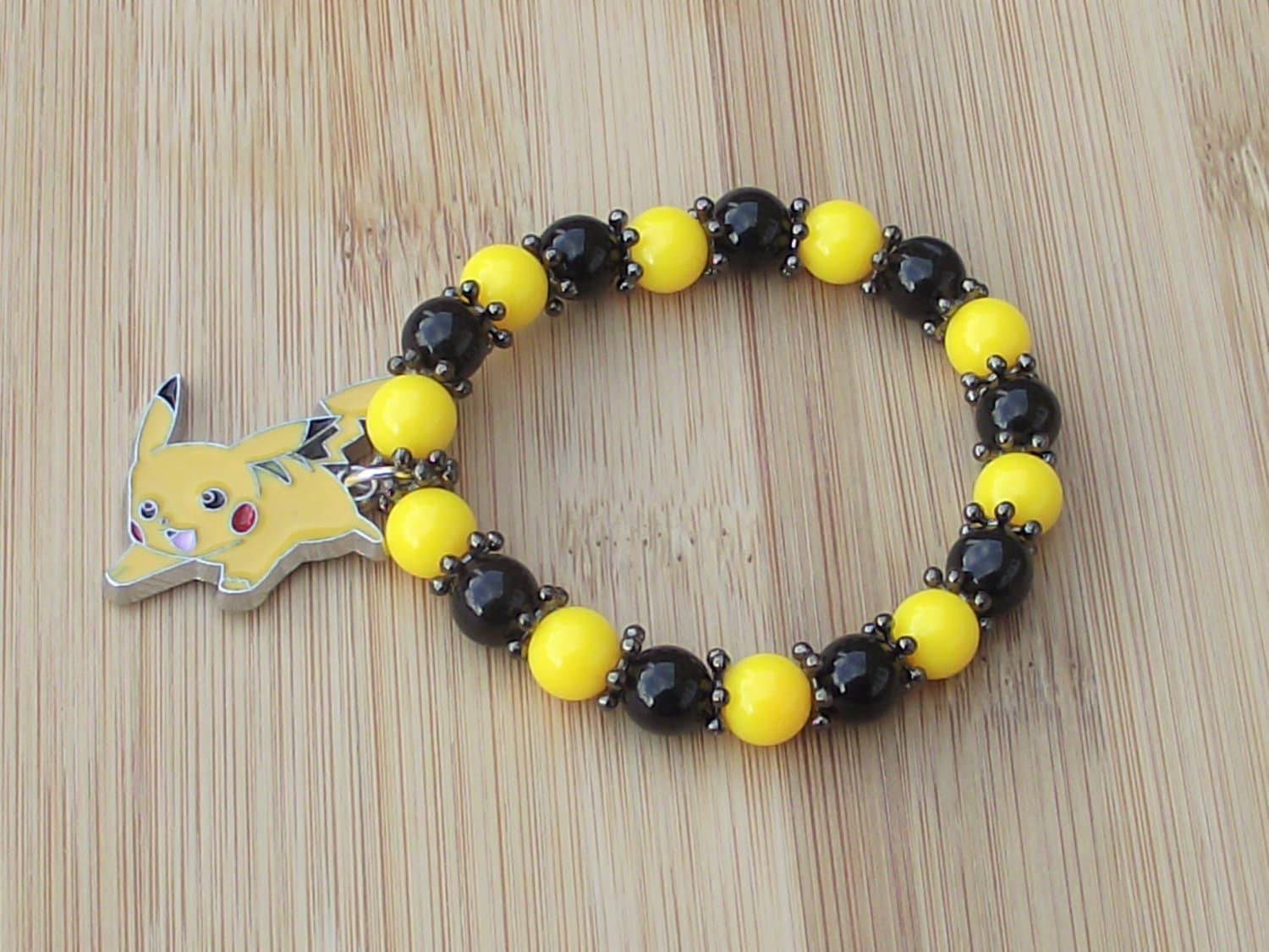 PIKACHU POKEMON Boys or Girls Adults Yellow  Black Beaded Handcrafted Stretchy Bracelet  With Enamel Pokemon Pikachu Dangle Charm