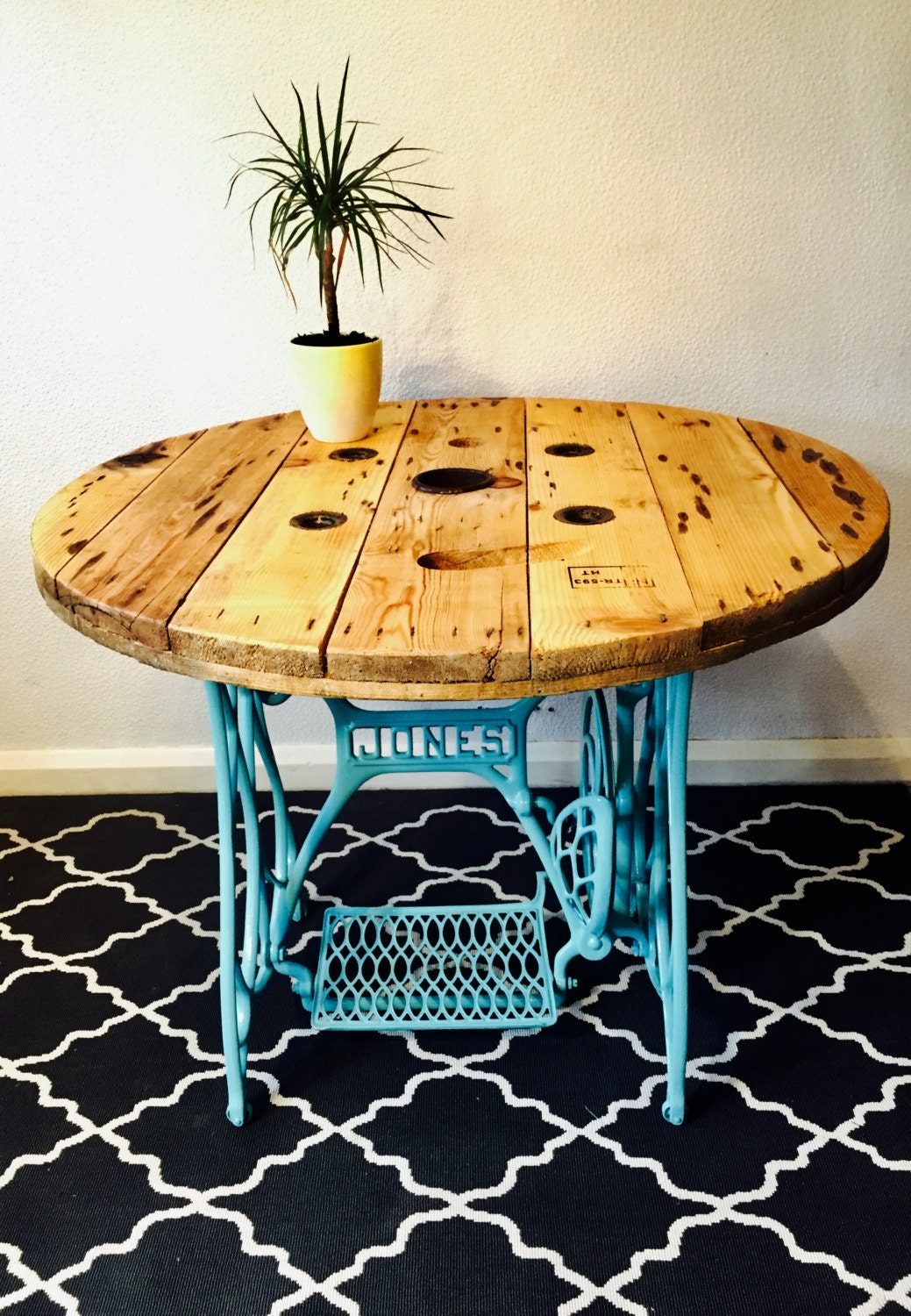 A cable reel dining table on Jones sewing machine base