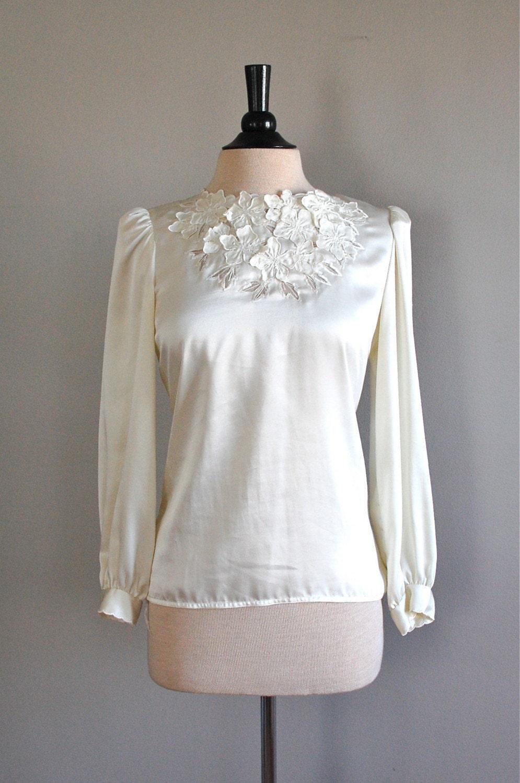 r e s e r v e d...vintage PALE PETALS cutout blouse