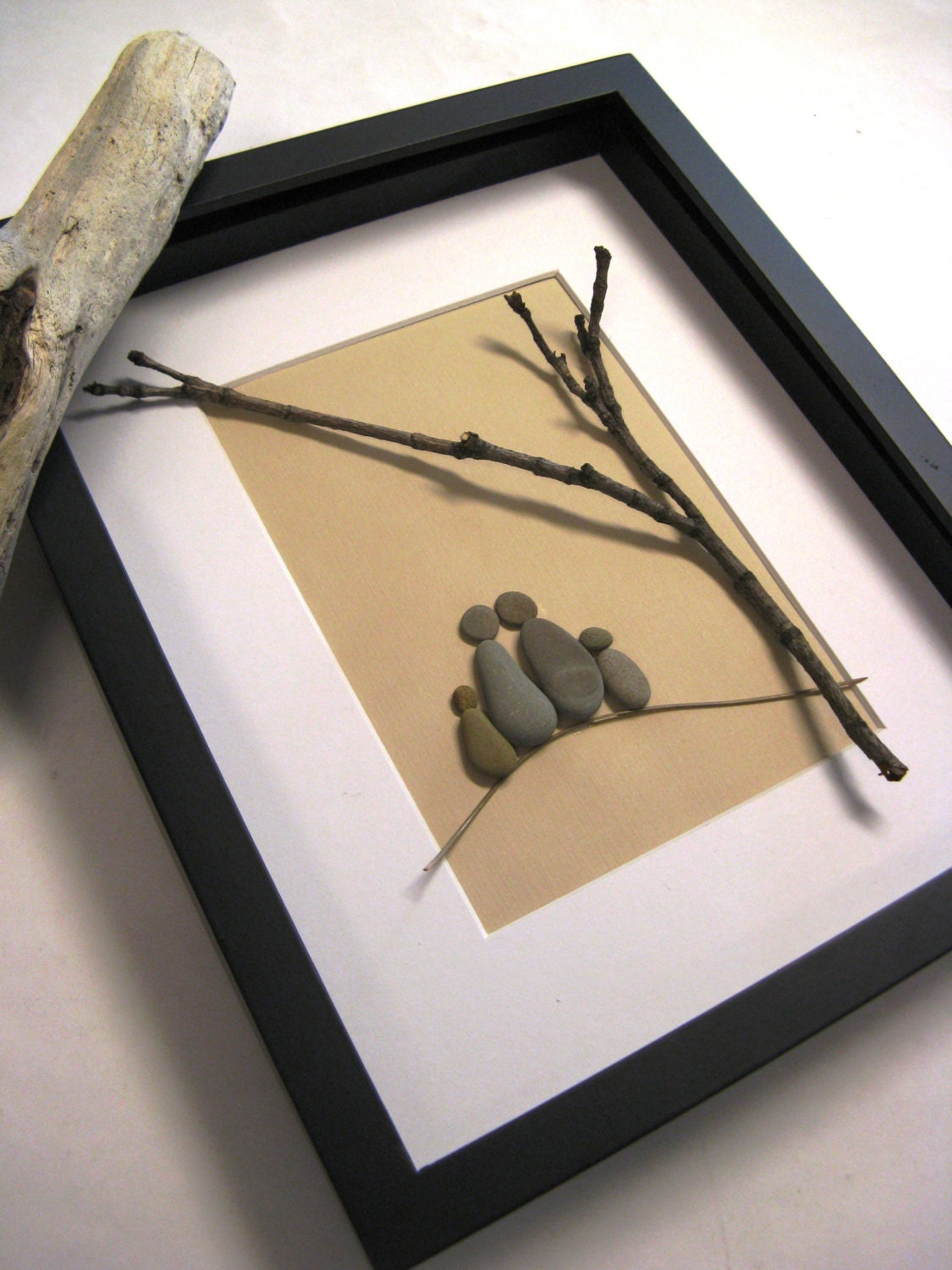 Framed beach stone family of four stone art by naturalware for Stone wall art